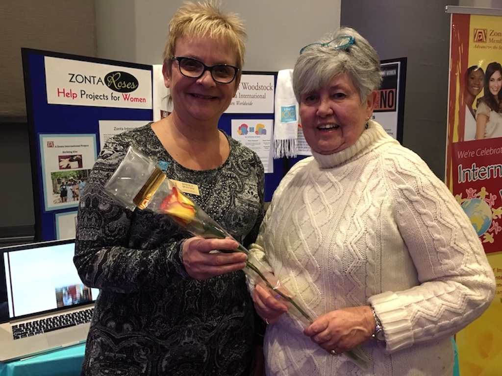 Zonta D4 Area 1 Director Accepts Rose from Woodstock President