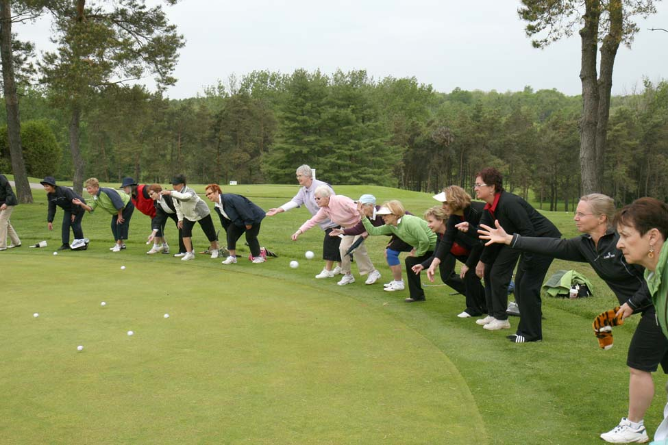 Golfers Tossing Golf Balls at Zonta Golf Classic